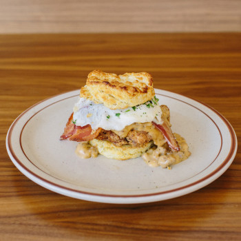 Biscuit Sandwich $12  Fried Chicken Breast, One Fried Free Range Egg, Gravy, Bacon (Add Breakfast Potatoes + $4.00)