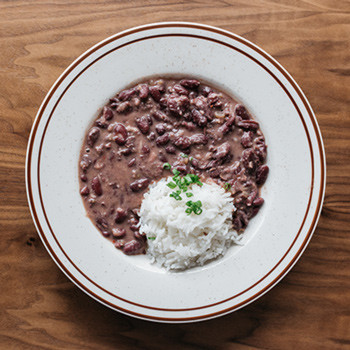 Red Beans & Rice $12 Smoked Ham Hock, Pickle Pork (Add Fried Chicken, Fried Shrimp, Fried Oyster, Fried Catfish, Fried Chicken Legs +$5)